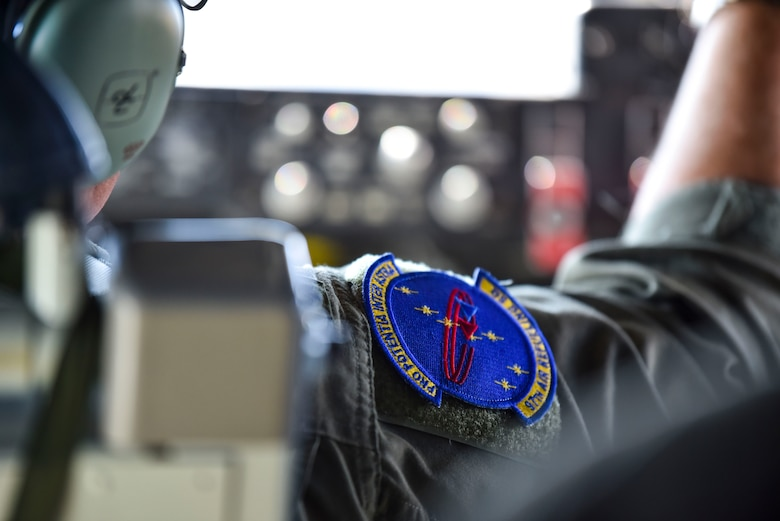 U.S. Air Force Lt. Col. Chris Dieter adjusts dials in the cockpit while flying over Idaho