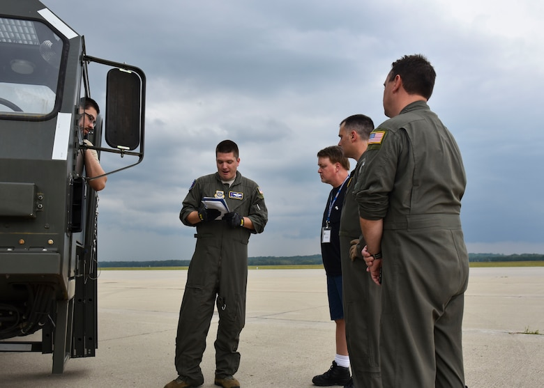U.S. Air Force Master Sgt. Joseph Ekker gives a brief to individuals from Data Monitor Systems and Airmen from the 97th ARS