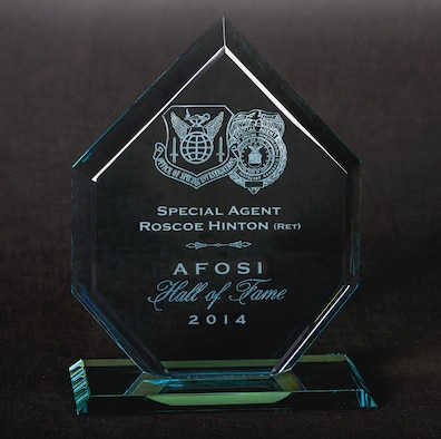 Each inductee into the Air Force Office of Special Investigations Hall of Fame receives an award like this one belonging to 2014 Hall of Fame Inductee Special Agent (Retired) Roscoe Hinton. (AFOSI photo by Michael Hastings)