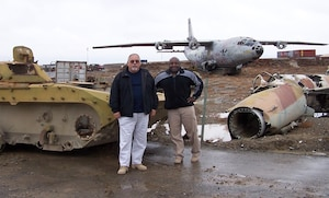 Air Force Office of Special Investigations Special Agent (Retired) and 2018 Hall of Fame Inductee Steve Minger (left) and SA Gary King pictured at the Russian equipment graveyard in Afghanistan in 2005. (AFOSI photo)