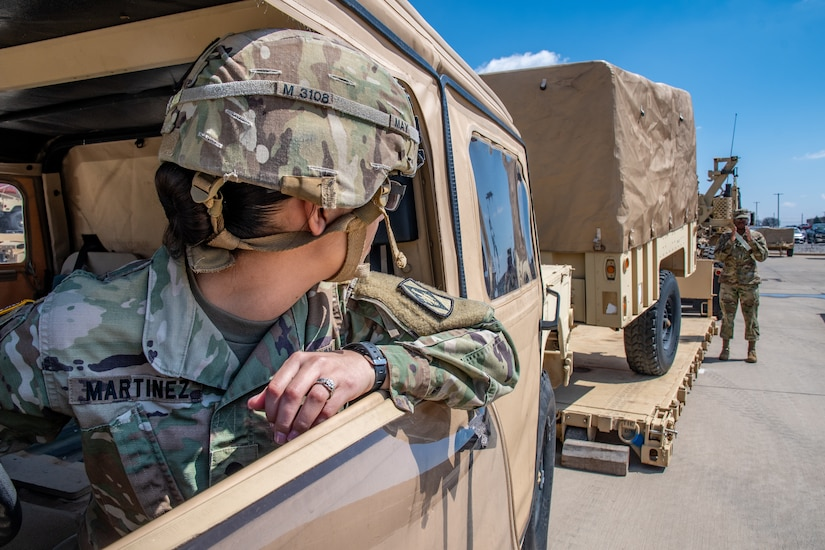 Spc. Chantal Martinez, a Motor Transportation Operator, assigned to 15th Transportation Company, 100th Brigade Support Battalion, 75th Field Artillery Brigade, Fort Sill, OK, carefully backs up an M1097 High Mobility Multipurpose Wheeled Vehicle (HMMWV) with an attached M1101 Cargo Trailer with the help of a ground guide on March 20, 2019. (U.S. Army Photo by Sgt. Dustin D. Biven)