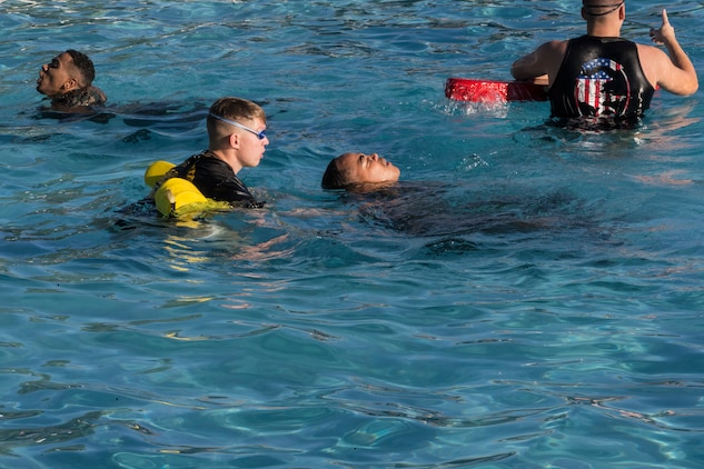 U.S. Marines stationed at Marine Corps Air Station Yuma complete their bi-annual swim qualification at the Oasis Pool on Aug. 27, 2019. Marines are known for being an amphibious assault force, so they regularly train in water to become more adept while swimming. ( Marine Corps photo by Cpl. Austin Weck)