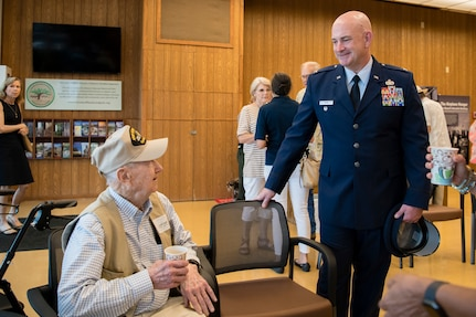 Col. Phillip G. Born, 37th Training Wing vice commander, speaks with Barney Hulett, one of Lyndon B. Johnson's former pilots, at the LBJ Birthday Observance Reception Aug. 27 at the LBJ National Historical Park at Johnson City, Texas. The annual event honors what would have been Johnson's 111th birthday.