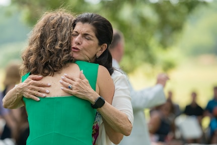 Luci Baines Johnson (right), Lyndon B. Johnson's daughter, hugs her niece Catherine Robb, at the Lyndon B. Johnson Birthday Observance Wreath-Laying Ceremony Aug. 27 at the LBJ National Historical Park at Johnson City, Texas.The annual event honors what would have been Johnson's 111th birthday.