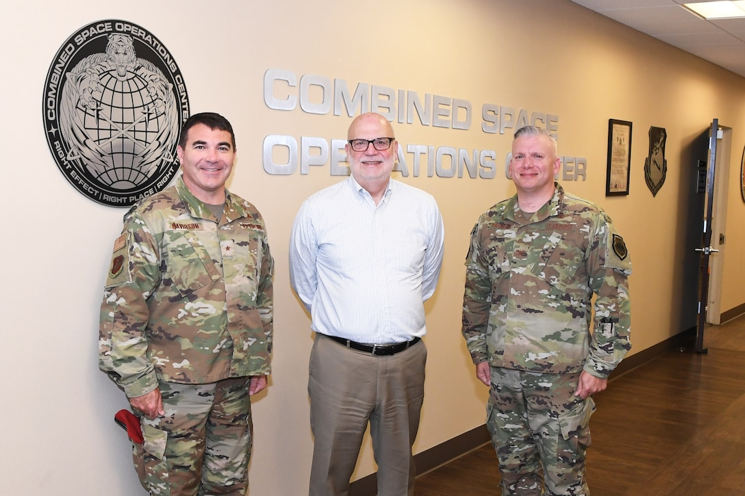 John Roth, performing the duties of the Under Secretary of the Air Force (center), poses for a photo with Brig. Gen. Matthew Davidson, 14th Air Force vice commander (left), and Col. Scott Brodeur, Combined Space Operations Center (CSpOC) director (right), during a visit at Vandenberg AFB, Calif., Aug. 27, 2019