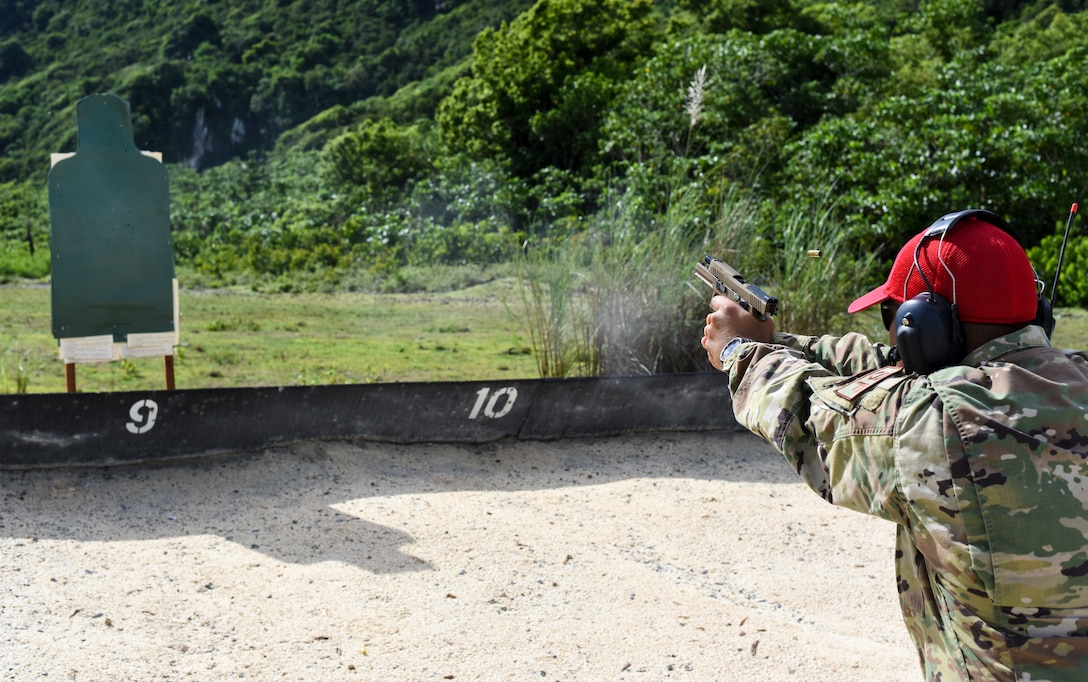 Tech Sgt. Kevin Tajalle, 36th Security Forces Squadron combat arms instructor, fires a Sig Sauer M18 pistol on Andersen Air Force Base, Guam, Aug. 27, 2019.