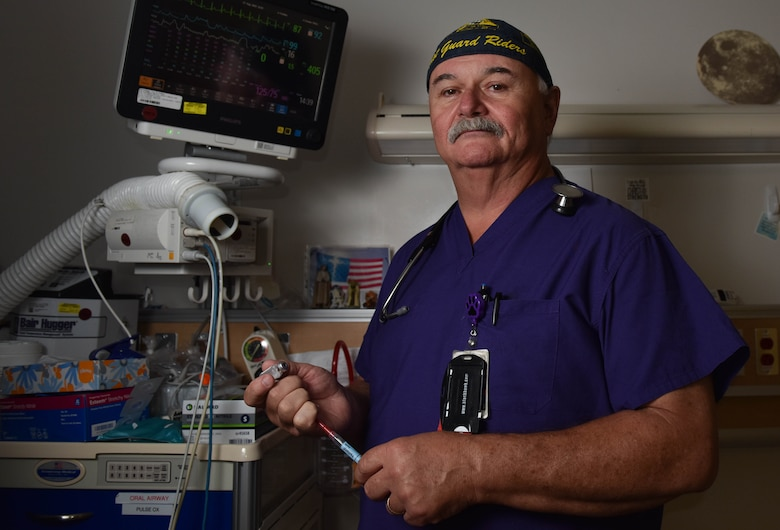 Jeffrey Barbour, 633rd Medical Group same day surgery and post anesthesia unit, monitors a patient's vitals at Joint Base Langley-Eustis, Virginia, Aug. 16, 2019. Barbour's interest in medical care began when he was very young and joined the Fire Department. (U.S. Air Force photo by Airman 1st Class Sarah Dowe)