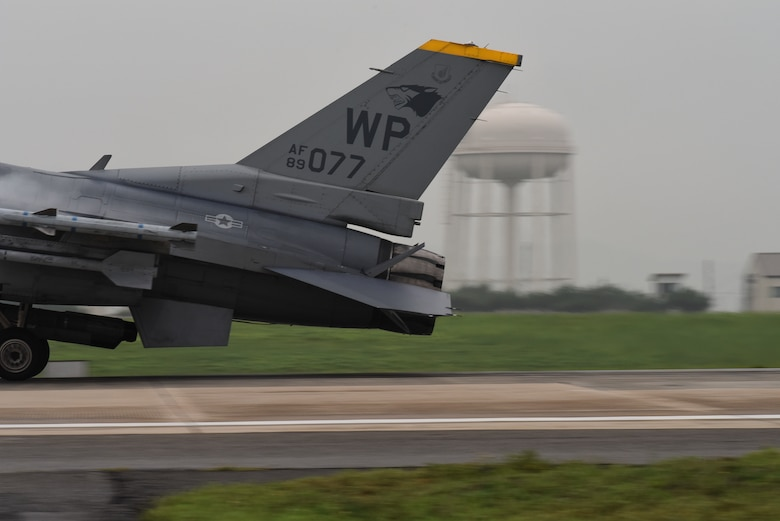 "A U.S. Air Force F-16 Fighting Falcon from the 80th Fighter Squadron ""Juvats"", lands following a routine training flight at Kunsan Air Base, Republic of Korea, Aug. 28, 2019. The 80th FS is one of two fighter squadrons assigned to the 8th Fighter Wing. The squadron was originally activated during World War II in 1942, as the 80th Pursuit Squadron. (U.S. Air Force photo by Staff Sgt. Mackenzie Mendez)"