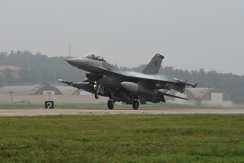 "A U.S. Air Force F-16 Fighting Falcon assigned to the 8th Operations Group lands following a routine training flight at Kunsan Air Base, Republic of Korea, Aug. 28, 2019. The 8th OG equips and trains the 35th Fighter Squadron ""Pantons"" and 80th FS ""Juvats"" to conduct air-to-ground and air-to-air missions. (U.S. Air Force photo by Staff Sgt. Mackenzie Mendez)"