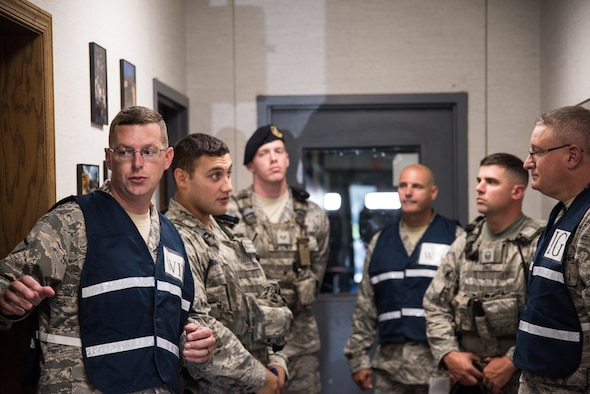 166th Security Forces Airmen gather for an after-action briefing, following an active shooter exercise, at New Castle Air National Guard Base, Aug. 22, 2019. The purpose of this exercise was to provide members of the 166th Airlift Wing with a greater awareness and understanding of possible threats, as well as test their ability to respond properly in the event of an active shooter situation. (U.S. Air National Guard Photo by Mr. Mitchell Topal)