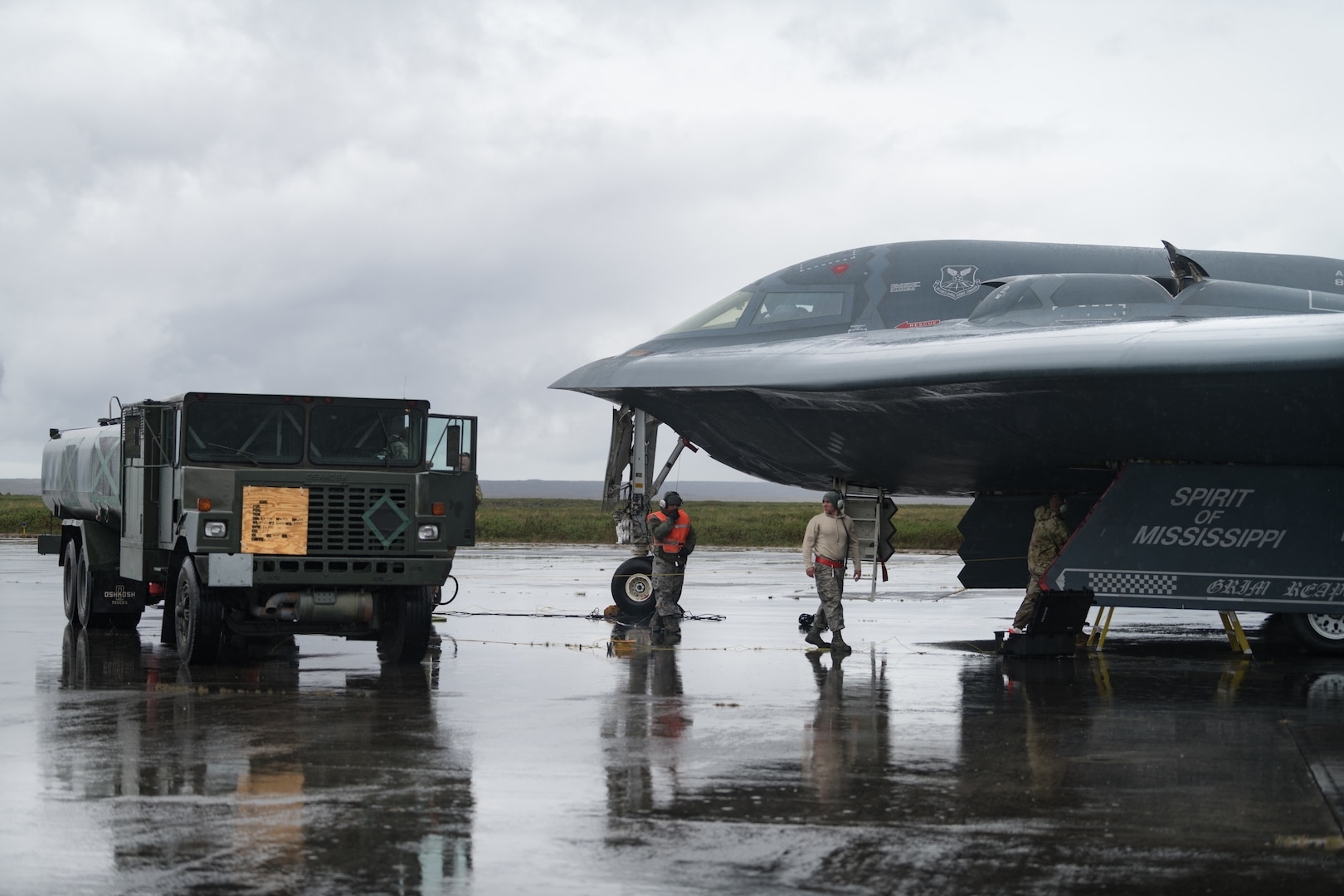 509th Logistics Readiness Squadron fuel distribution operators from Whiteman Air Force Base, Missouri conduct a hot-pit refueling on a B-2 Spirit Bomber at Naval Air Station Keflavik, Iceland, August 28, 2019. Hot-pit refueling is a method of refueling an aircraft without shutting down the engines. This is the B-2s first time landing in Iceland. Forward locations like Iceland enhance the collective defense capabilities of both the U.S. and NATO allies partners. (U.S. Air Force photo by Senior Airman Thomas Barley)