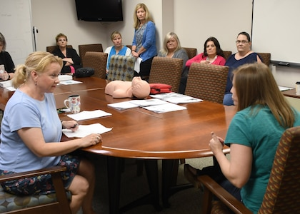 Susan Heap (left), a nurse case manager with the 10th Combat Aviation Brigade, 10th Mountain Division (Light Infantry)'s embedded behavioral health, attempts to calm a role-playing patient down as other behavioral health nurses observe during a combative patient mock drill at the Wilcox Behavioral Health clinic on Fort Drum Aug. 8.