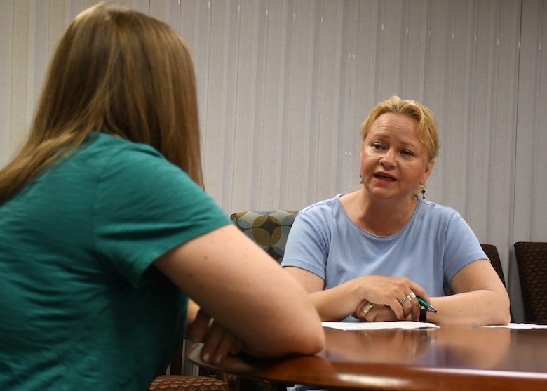 Susan Heap, a nurse case manager with the 10th Combat Aviation Brigade, 10th Mountain Division (Light Infantry)'s embedded behavioral health, attempts to calm a role-playing patient down during a combative patient mock drill at the Wilcox Behavioral Health clinic on Fort Drum Aug. 8.