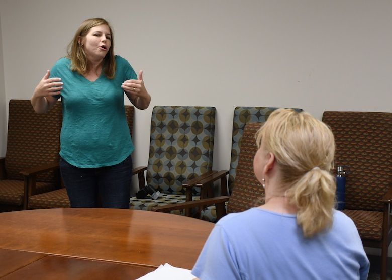 Elizabeth Keen, a library technician with the U.S. Army Medical Department Activity (MEDDAC), Fort Drum, role plays the part of a combative patient during a training scenario at the Wilcox Behavioral Health clinic on Fort Drum Aug. 8.