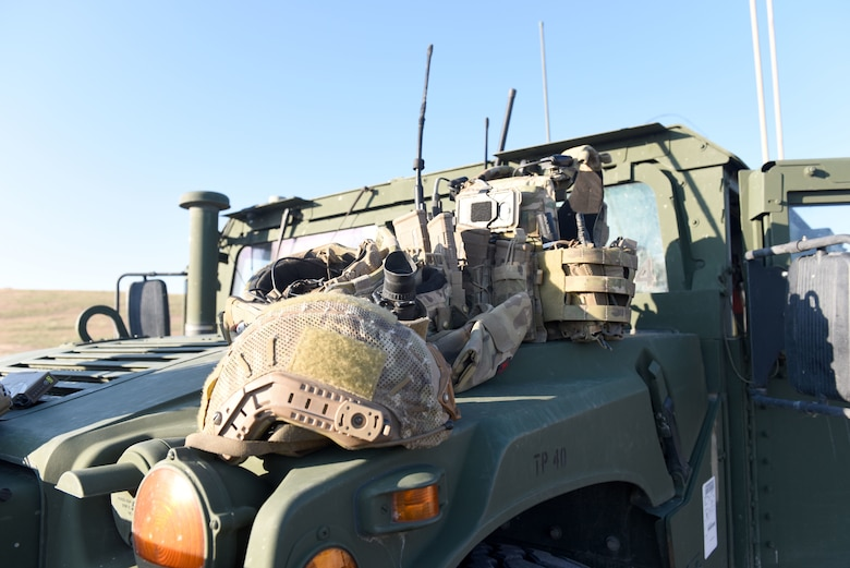 Tactical Air Control Party Specialists from the 148th Air Support Operations Squadron load up their gear and vehicle.