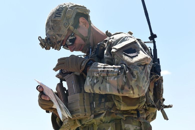 Senior Airman Zeljko Raic, a Tactical Air Control Party Specialist with the 148th Air Support Operations Squadron, checks his coordinates.