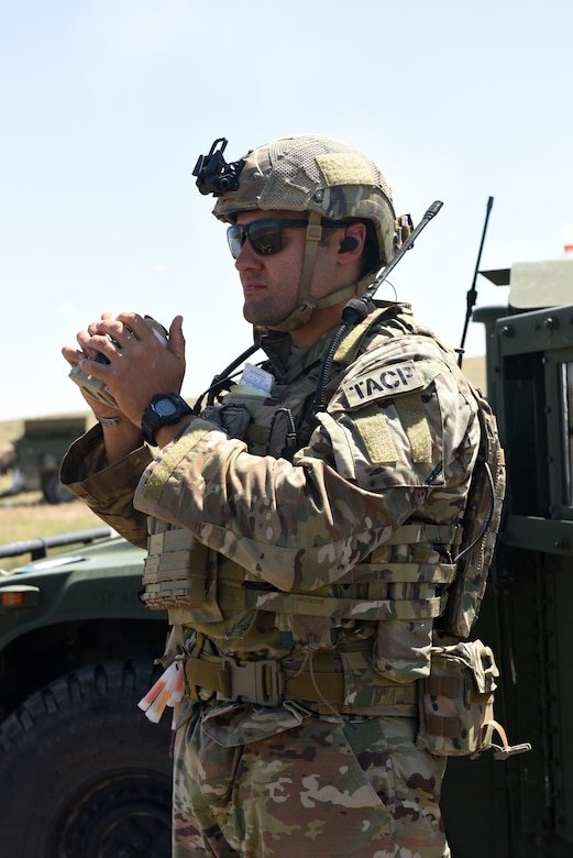 U.S. Air Force Tech. Sgt. Devon Kuny, a Joint Terminal Attack Controller with the 148th Air Support Operations Squadron, uses a laser range finder to help determine distance while coordinating an air strike.