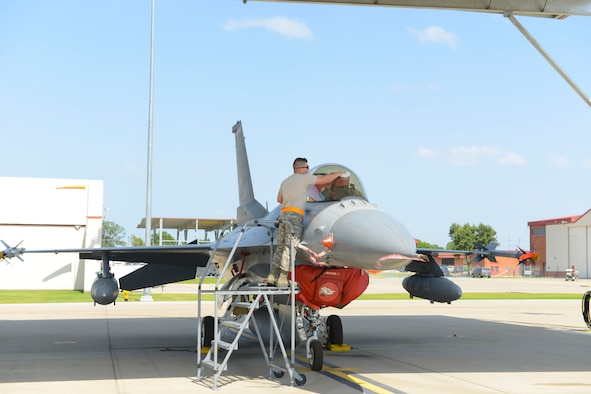 Staff Sgt. Cody Brown, 138th Maintenance Squadron, polishes the canopy of an F-16 fighter jet as part of the post-flight procedures on July 13, 2016 at the 138th Fighter Wing. The wraparound canopy provides ideal light in-flight and can withstand the impact of a 4 pound bird at 550 knots. (Air National Guard photo/Master Sgt. Roberta A. Thompson)