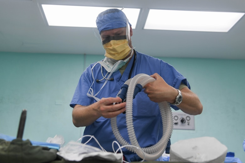 Col. Greg Malone, an anesthesiologist assigned to the 88th Medical Group from Wright Patterson Air Force Base, prepares medical equipment for a hysterectomy surgery during New Horizons exercise 2019 at the Linden MacKenzie Hospital in Linden, Guyana. U.S. military members provided women's health surgical services to reduce a backlog of patients awaiting care due to Guyana's limited medical resources. (U.S. Air Force photo/Senior Airman Derek Seifert)