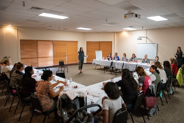 Spouse of the years conducts workshop with militry spouses.