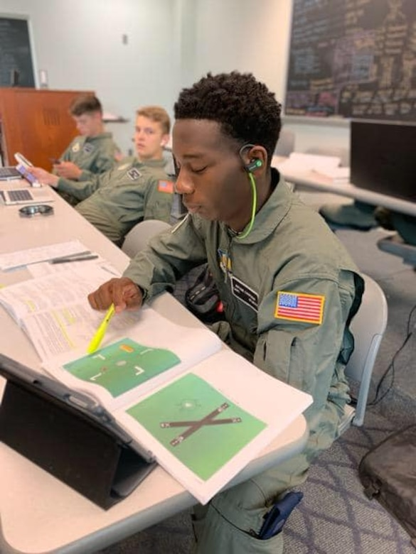An Air Force Junior ROTC cadet focuses hard on his studies at Delaware State University, Dover, Delaware.  This summer, 150 cadets were sent to 11 universities across the country for an intensive eight-week Air Force JROTC Flight Academy program, with 45 percent of the class being female or minority.  At the end of the program, 122 high school students walked away with a positive university experience, college credit and their private pilot certification.
