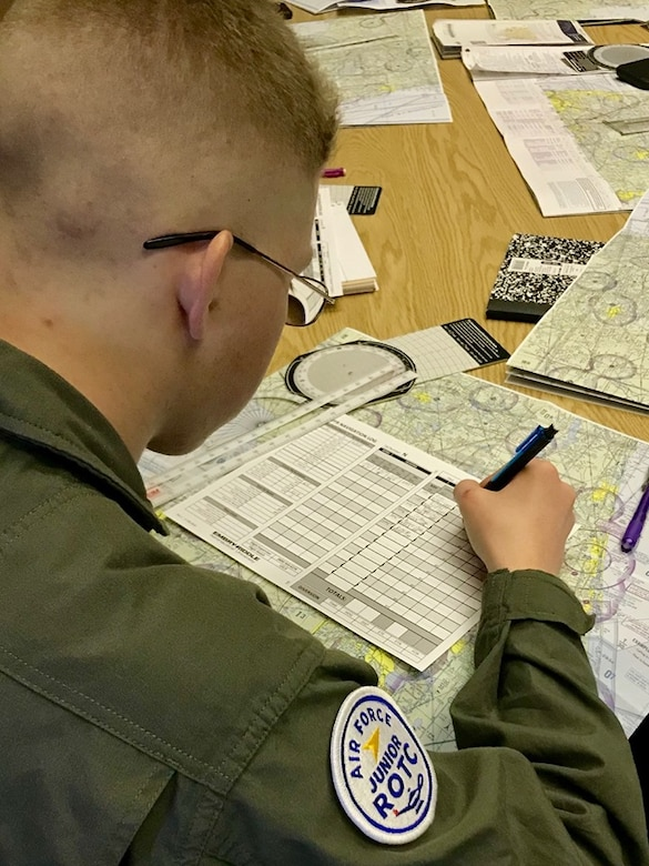 An Air Force Junior ROTC cadet at Southeastern University, Lakeland, Florida, focuses his attention on filing a flight plan as he participates in the Air Force JROTC Flight Academy.  The Flight Academy is a Chief of Staff of the Air Force Scholarship Program intended to expose high school students to the benefits of a career in aviation.  More than 1,560 cadets applied for one of the 150 scholarships each valued at approximately $20,000.  The cadets were competitively boarded to ensure only the most qualified cadets were sent to the partner universities.
