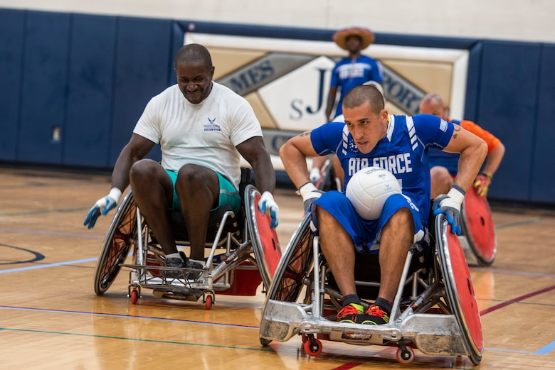 Master Sgt. Quinn Harrington, Air Force Wounded Warrior, races down the court during a wheelchair rugby game for the Air Force Wounded Warrior CARE event, Aug. 23, 2019 at Scott Air Force Base, Ill. During the week, Harrington also competed in sitting volleyball and field events. (U.S. Air Force photo by Senior Airman Daniel Garcia)