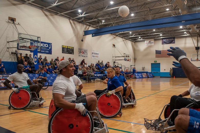 Air Force Wounded Warriors play a game of wheelchair rugby against volunteers, during the AFW2 CARE event Aug. 23, 2019 at Scott Air Force Base, Ill. Throughout the week, program participants and volunteers were given time to learn the rules of the game, practice and get comfortable with racing up and down the court in wheelchairs. (U.S. Air Force photo by Senior Airman Daniel Garcia)