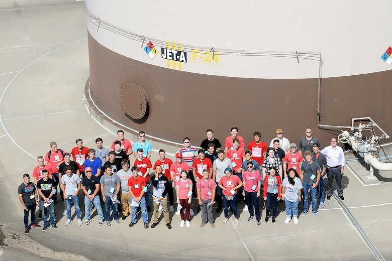 University of Nebraska at Lincoln (UNL) students and U.S. Army Corps of Engineers (USACE) tour guides pose in front of fuel tanks Aug. 23, 2019, at Offutt Air Force Base, Nebraska. Offutt is able to provide engineering students examples of high-profile projects by partnering with organizations like the USACE and UNL.
