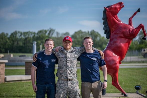 Brothers Tyler Jenkins, SrA Anthony Thielman and Dylan Jenkins, all members of the 200th REDHORSE Squadron, pose for a photograph May 19, 2019, at the 200th REDHORSE Squadron, Mansfield, Ohio. Dylan and Tyler recently enlisted into the Ohio Air Guard, following in the footsteps of their older brother. (U.S. Air National Guard photo by Airman 1st Class Alexis Wade)