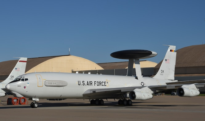 Boeing E-3G Airborne Warning and Control System aircraft, serial # 79-0001, wearing markings for the 552nd Air Control Wing Commander in the form of multi-colored tail-stripe, shadowed tail code and serial number markings on Aug. 12, 2019, Tinker Air Force Base, Oklahoma. The 55nd Air Control Wing, Air Combat Command, generates E-3 AWACS aircraft and crews to support 12th Air Force and Air Forces Southern. The 552nd ACW is known as 'American's Wing' as the largest wing within ACC. (U.S. Air Force photo/Greg L. Davis)