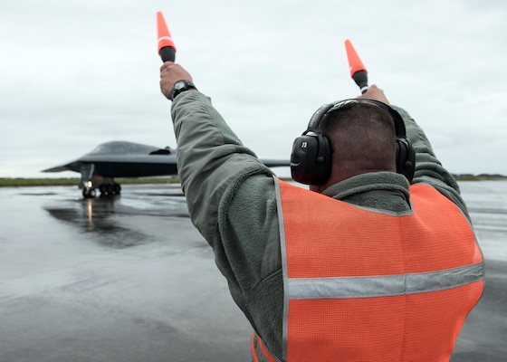 Master Sgt. Scott Smith, a hydraulics shop chief assigned to the 131st Maintenance Squadron Group, marshals a B-2 Spirit Stealth Bomber at Naval Air Station Keflavik, Iceland, August 28, 2019. This is the B-2s first time ever landing in Iceland. While in Iceland Airmen from Whiteman conducted hot-pit refueling, which is a method of refueling an aircraft without shutting down the engines. Training with partners, allied nations and other U.S. Air Force units contributes to our readiness and enables us to build enduring and strategic relationships necessary to confront a broad range of global challenges.