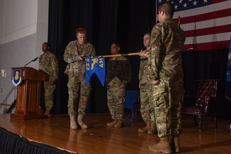 Senior Airman Alexander Cavender, 22nd Operational Medical Readiness Squadron bioenvironmental technician, furls the 22nd Aerospace Medicine Squadron guidon during a redesignation ceremony Aug. 29, 2019, at McConnell Air Force Base, Kan. The 22nd AMDS was redesignated to the 22nd OMRS respectively after 24 years. (U.S. Air Force photo by Airman 1st Class Marc A. Garcia)