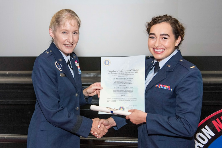 Brig. Gen. Jeannie Leavitt, Air Force Recruiting Service commander, presents 2nd Lt. Alyssa Garmon her certificate of aeronautical rating during Pilot Training Next graduation ceremony August 29, 2019, at Joint Base San Antonio-Randolph, Texas. The graduates, which included two Air National Guard students, were selected to fly airframes including the F-35 Lightning II, F-15E Strike Eagle, F-16 Fighting Falcon, C-17 Globemaster III, C-130 Hercules, EC-130 Compass Call, C-5 Galaxy, B-2 Spirit, C-146A Wolfhound, and the T-6 Texan II. (U.S. Air Force photo by Sean M. Worrell)