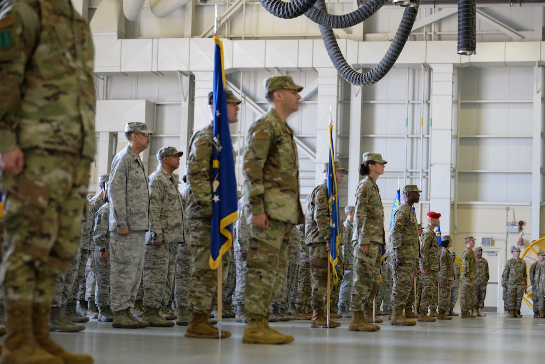 Second Air Force wing and group level commanders stand at attention during the Second Air Force  change of command ceremony on Keesler Air Force Base, Mississippi, Aug. 29, 2019. The ceremony is a symbol of command being exchanged from one commander to the next. Tullos assumed command of the Second Air Force from Maj. Gen. Timothy Leahy. (U.S. Air Force photo by Airman 1st Class Spencer Tobler)