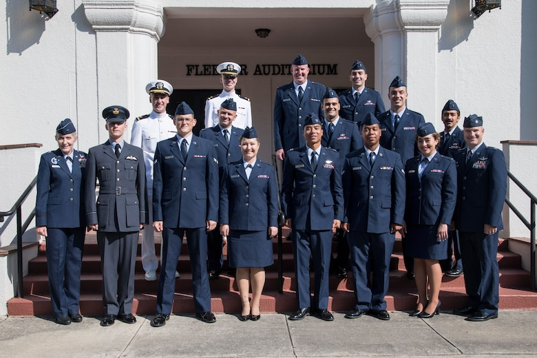 Pilot Training Next students pose for a group photo after graduation from the learning experiment's second iteration with Brig. Gen. Jeannie Leavitt, Air Force Recruiting Service commander, August 29, 2019, at Joint Base San Antonio-Randolph, Texas. PTN is a program to explore and potentially prototype a training environment that integrates various technologies to produce pilots in an accelerated, cost efficient, learning-focused manner. (U.S. Air Force photo by Sean M. Worrell)