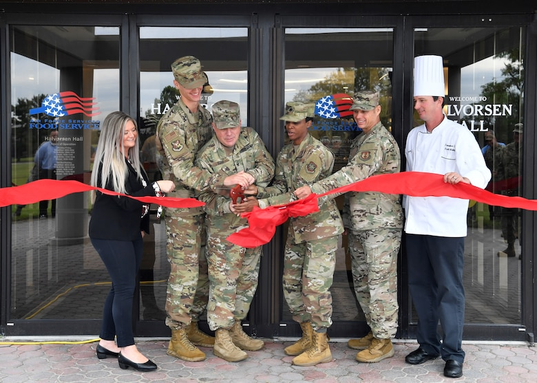 U.S. Army Col. Charles Durr, Army Support Activity commander, along with fellow 87th Air Base Wing Force Support Squadron leadership, cut the ceremonial ribbon for the re-opening of the Halvorsen Hall Dining Facility on Joint Base McGuire-Dix-Lakehurst, New Jersey, Aug. 27, 2019. While closed, the DFAC underwent renovations and changed their food options to align with Food 2.0, an Air Force initiative to offer healthier food options and expanding food choices. An additional change includes utilization of the DFAC for all Joint Base MDL community members.