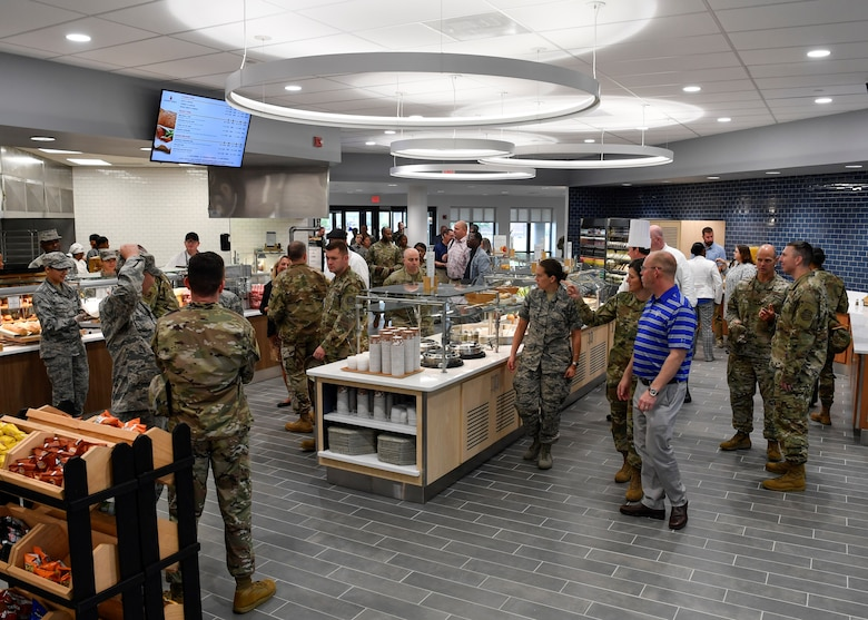 Customers walk around the renovated Halvorsen Hall Dining Facility on Joint Base McGuire-Dix-Lakehurst, New Jersey, during the re-opening on Aug. 27, 2019. The DFAC underwent renovations and transitioned to Food 2.0, an Air Force initiative to bring healthier food options to individuals while also expanding food choices. An additional change includes utilization of the DFAC for all Joint Base MDL community members.