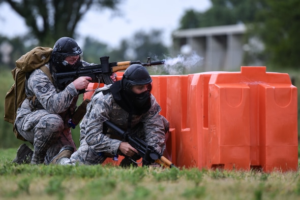 Staff Sgt. Aaron Wooton, 22nd Aerospace Medicine Squadron operational medical technician, and Airman 1st Class Ruben Toledo-Bravo 22nd Medicine Support Squadron health services management apprentice, participate in an Emergency Medical Technician Rodeo Aug. 22, 2019, at McConnell Air Force Base, Kan. The rodeo consisted of medical technicians armed with paintball guns enduring a simulated combat scenario while trying to identify and perform combat care tactics. (U.S. Air Force photo by Airman 1st Class Alexi Myrick)