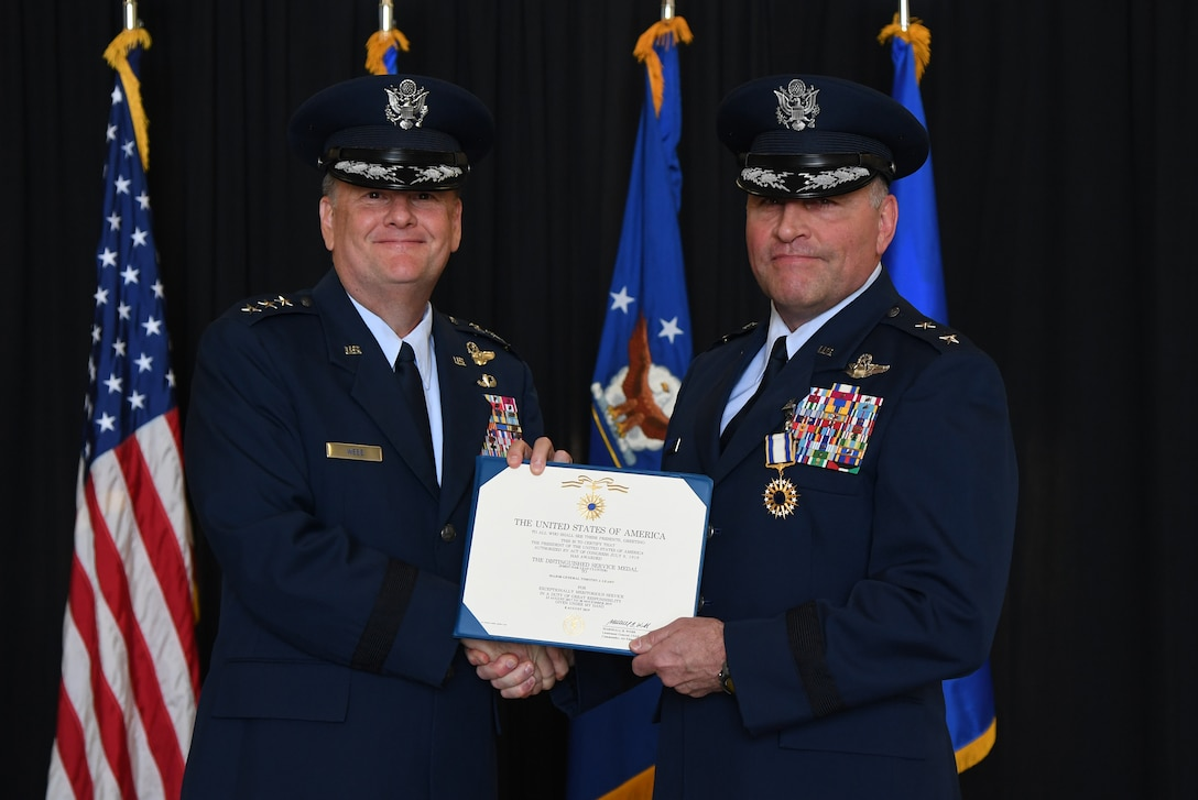 U.S. Air Force Lt. Gen. Brad Webb, commander of Air Education and Training Command, presents the Distinguished Service Medal certificate to Maj. Gen. Timothy Leahy, Second Air Force commander, during the Second Air Force change of command ceremony on Keesler Air Force Base, Mississippi, Aug. 29, 2019. The ceremony is a symbol of command being exchanged from one commander to the next. Leahy relinquished command of the Second Air Force to Maj. Gen. Andrea Tullos. (U.S. Air Force photo by Kemberly Groue)