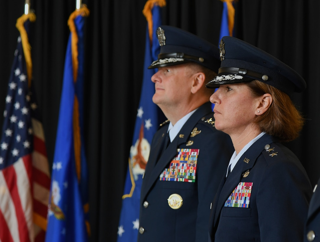 U.S. Air Force Lt. Gen. Brad Webb, commander of Air Education and Training Command, and Maj. Gen. Andrea Tullos, Second Air Force commander, stand at attention during the Second Air Force change of command ceremony on Keesler Air Force Base, Mississippi, Aug. 29, 2019. The ceremony is a symbol of command being exchanged from one commander to the next. Tullos assumed command of the Second Air Force from Maj. Gen. Timothy Leahy. (U.S. Air Force photo by Kemberly Groue)