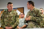 Col. Jeffrey Gomes, 624th Operations Center commander (right), briefs Gen. Tod Wolters, commander of U.S. European Command, at Joint Base San Antonio-Lackland Aug. 28. Wolters visited the 624th Operations Center to learn about the center's command and control mission, and to meet cyber Airmen.