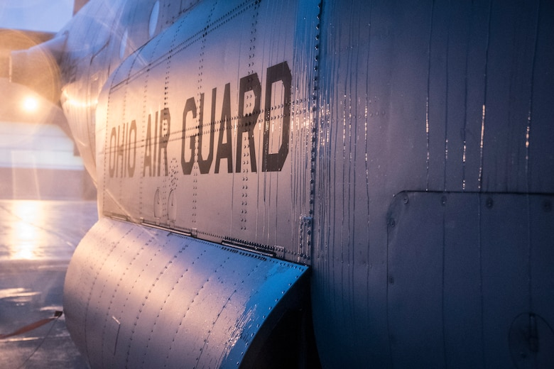 A photo of sun reflecting off the side of a C-130 that says Ohio Air Guard.