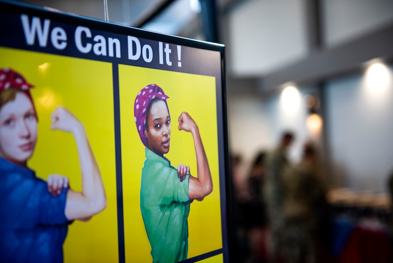A poster hangs while guests get cultural cuisine during the third annual 23d Wing Diversity Day Aug. 29, 2019, at Moody Air Force Base, Ga. Diversity Day honored the cultures of all groups and organizations observed by the Department of Defense, from LGBTQ equality to Native American heritage, and brought Airmen from across the base together to celebrate their unique differences. This year's theme was 'It's not just black and white, open your palette, create a culture of possibilities.' (U.S. Air Force photo by Senior Airman Erick Requadt)