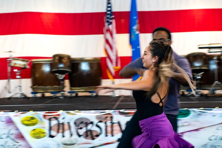 Ryan Johnson and Laura Avila, Valdosta State University students, perform a salsa dance during the third annual 23d Wing Diversity Day Aug. 29, 2019, at Moody Air Force Base, Ga. Diversity Day honored the cultures of all groups and organizations observed by the Department of Defense, from LGBTQ equality to Native American heritage, and brought Airmen from across the base together to celebrate their unique differences. This year's theme was 'It's not just black and white, open your palette, create a culture of possibilities.' (U.S. Air Force photo by Senior Airman Erick Requadt)
