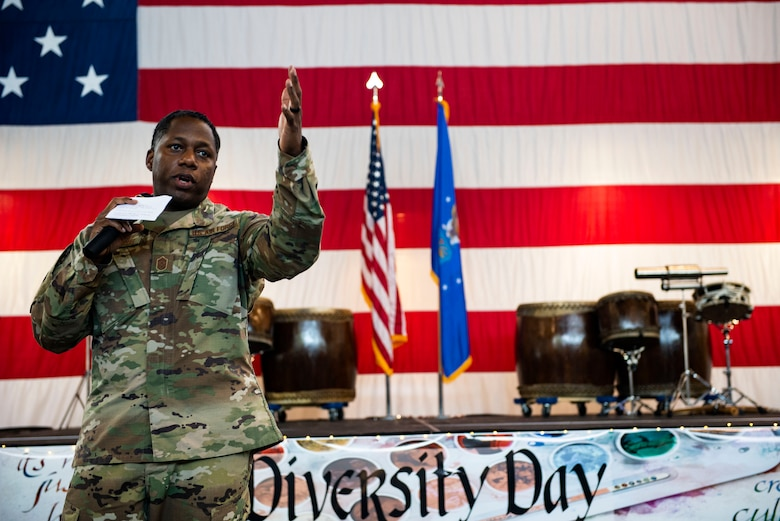 Chief Master Sgt. Terrence Edwards, 93d Air Ground Operations Wing command chief, gives a speech during the third annual 23d Wing Diversity Day Aug. 29, 2019, at Moody Air Force Base, Ga. Diversity Day honored the cultures of all groups and organizations observed by the Department of Defense, from LGBTQ equality to Native American heritage, and brought Airmen from across the base together to celebrate their unique differences. This year's theme was 'It's not just black and white, open your palette, create a culture of possibilities.' (U.S. Air Force photo by Senior Airman Erick Requadt)