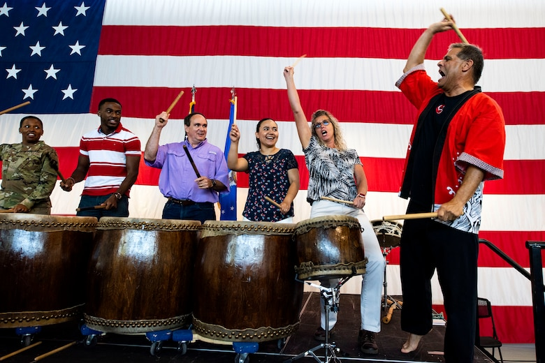 Team Moody Airmen participate in a drumming demonstration with the Tampa Taiko drummers during the third annual 23d Wing Diversity Day Aug. 29, 2019, at Moody Air Force Base, Ga. Diversity Day honored the cultures of all groups and organizations observed by the Department of Defense, from LGBTQ equality to Native American heritage, and brought Airmen from across the base together to celebrate their unique differences. This year's theme was 'It's not just black and white, open your palette, create a culture of possibilities.' (U.S. Air Force photo by Senior Airman Erick Requadt)