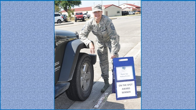 Master Sgt. Melissa Erwin, 340th Flying Training Group information technology superintendent, stakes her claim to the commander's parking spot following selection as the 340th FTG August On-the-Spot Award winner. Nicely Done Melissa! (U.S. Air Force photo by Janis El Shabazz)