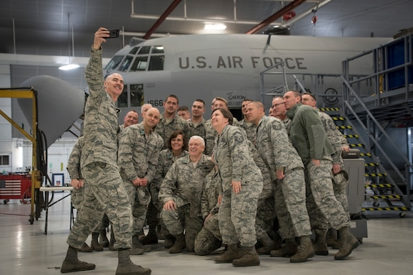 """U.S. Air Force Lt. Gen. L. Scott Rice, director, Air National Guard, and Chief Master Sgt. Ronald Anderson, Command Chief of the Air National Guard, pose for a selfie with Maintenance Group members during a visit to the 179th Airlift Wing, Mansfield, Ohio, April 11, 2018. Rice met with leadership and visited Airmen across the wing to learn about their mission and ended the visit with an """"All Call"""" event where several Airmen were recognized for recent achievements. (U.S. Air National Guard photo by Tech. Sgt. Joe Harwood\Released)"""