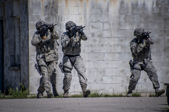 Airmen from the 179th Airlift Wing Security Forces Squadron, Mansfield, Ohio, use Simunition dye-filled non-lethal rounds to provide realistic training June 2, 2018, at the Military Operations in Urban Terrain complex at Alpena Combat Readiness Traning Center, Alpena, Michigan. The training is focused on full spectrum readiness preparing the wing to respond to local, state or federal activations at a moments notice. (U.S. Air National Guard photo by Tech. Sgt. Joe Harwood/Released)